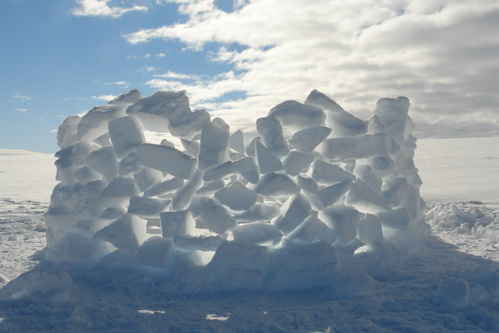 alternative igloo made from igloo offcuts before reclaimed by wind and snow